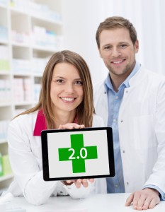 http://www.dreamstime.com/stock-photo-female-pharmacist-displaying-blank-tablet-smiling-attractive-young-screen-to-camera-watched-male-colleague-image37846880